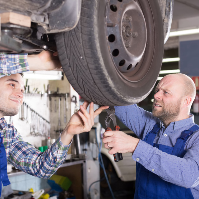 """Two specialist fixing car"" stock image"