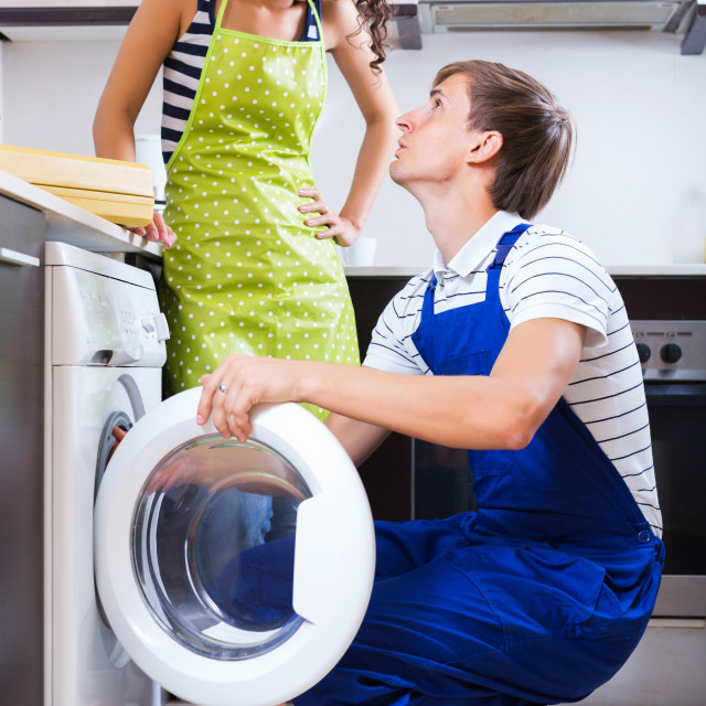 """Specialist in uniform consulting housewife"" stock image"