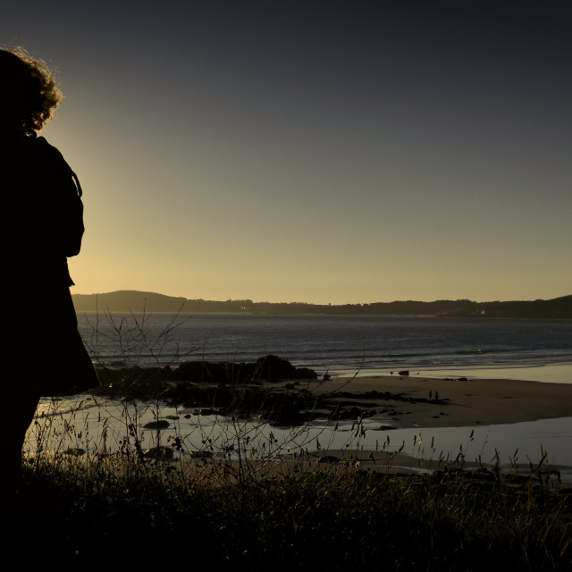 """Woman and Sunset"" stock image"