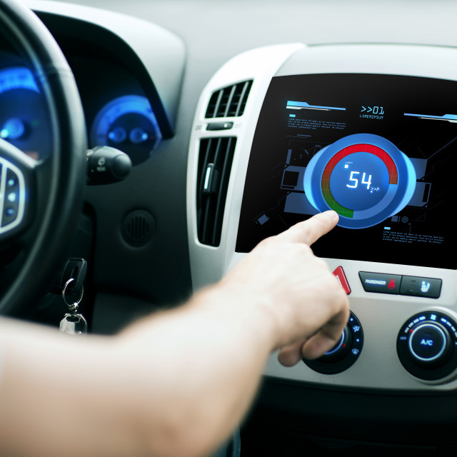 """""""hand setting volume on car audio stereo system"""" stock image"""
