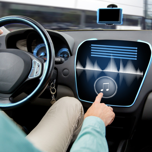 """""""close up of man driving car with audio system"""" stock image"""