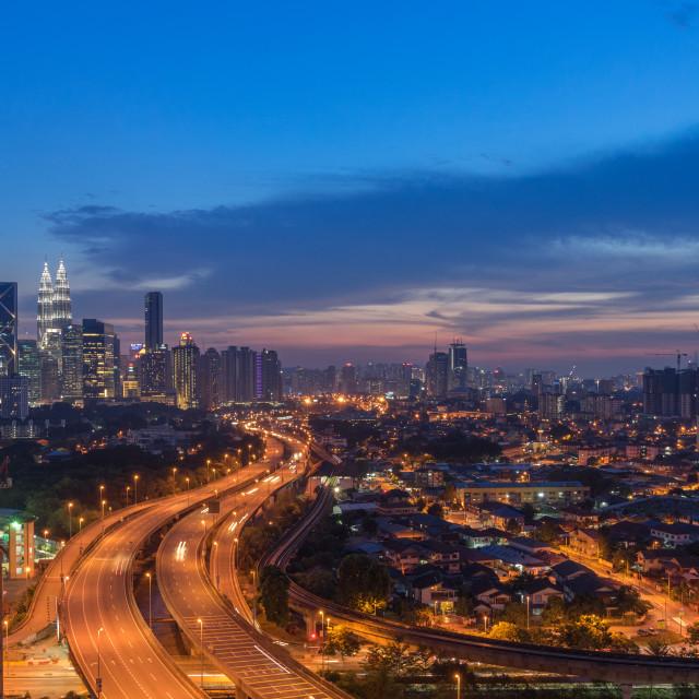 """Dramatic sunset over Kuala Lumpur City Skyline"" stock image"