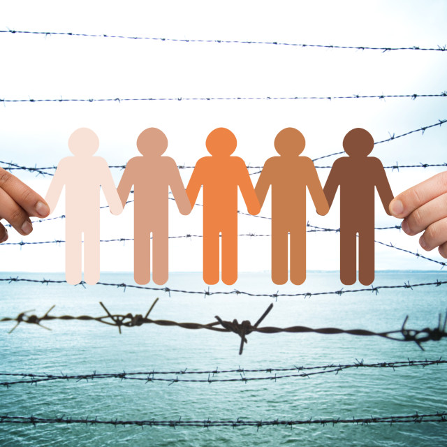 """""""hands holding people pictogram over barb wire"""" stock image"""