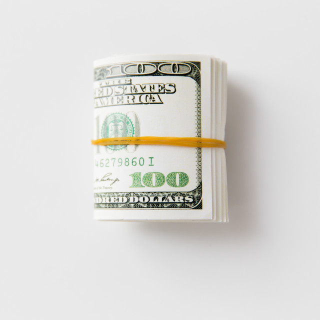 """""""close uop of dollar money packet tied with rubber"""" stock image"""