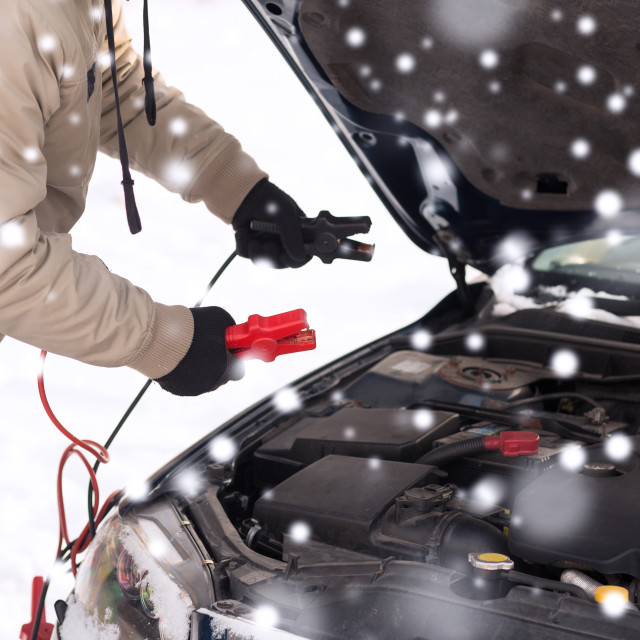 """""""closeup of man under bonnet with starter cables"""" stock image"""