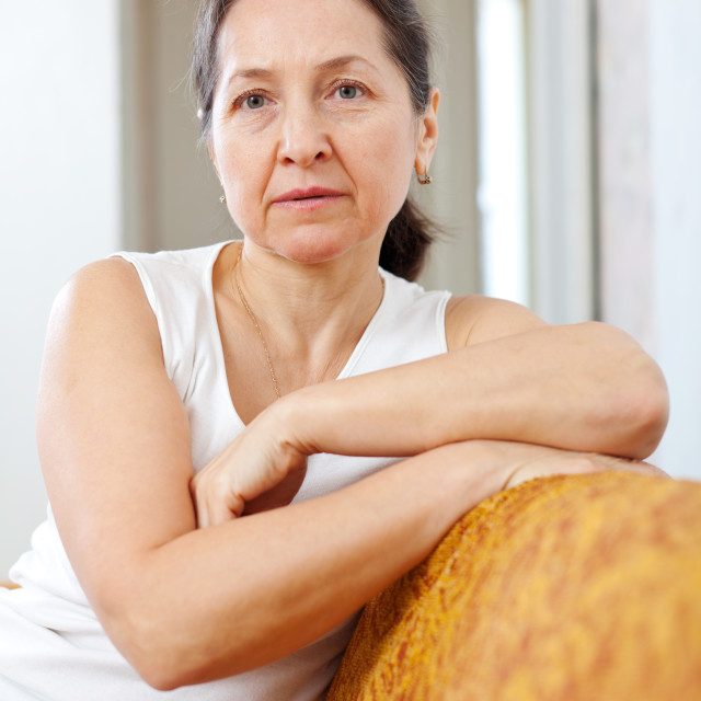 """""""wistful beauty mature woman in home"""" stock image"""