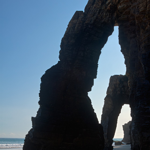 """Natural arches at As Catedrais beach"" stock image"