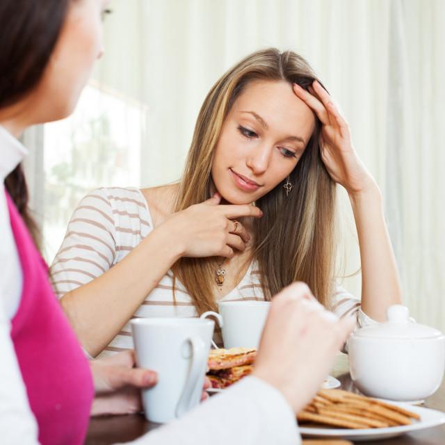 """Sad woman telling to friend"" stock image"