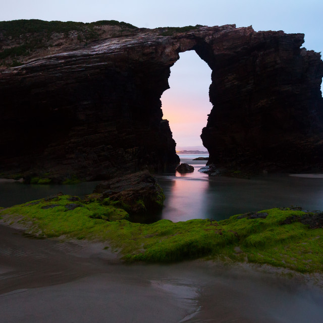 """Natural arch at As Catedrais beach in sunrise-"" stock image"