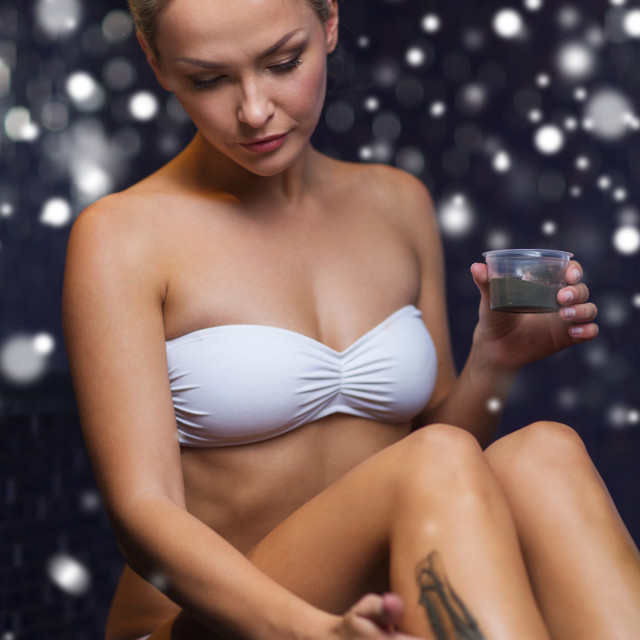 """woman applying therapeutic mud in spa or sauna"" stock image"