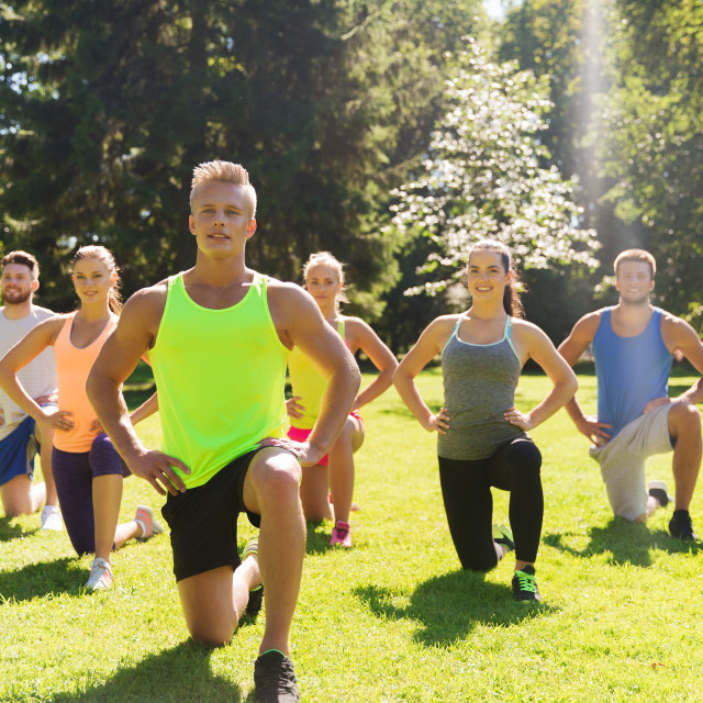 """""""group of friends or sportsmen exercising outdoors"""" stock image"""