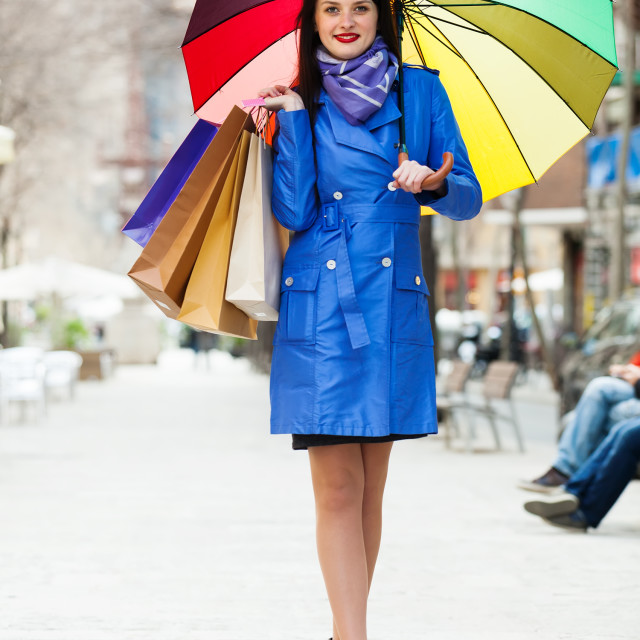 """""""woman in blue with shopping bags and umbrella at street"""" stock image"""