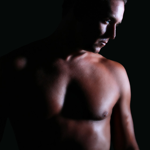 """A shot of a topless muscular young man"" stock image"