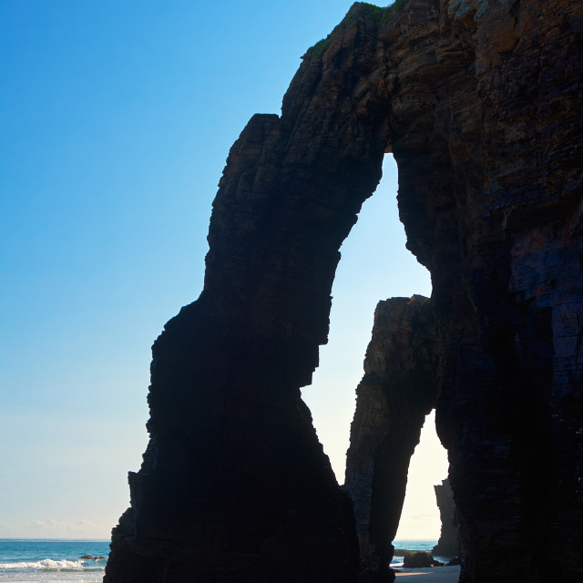 """Natural arch in rocks at As Catedrais beach"" stock image"