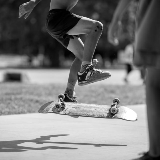 """Boy is making skate tricks in a skate park"" stock image"