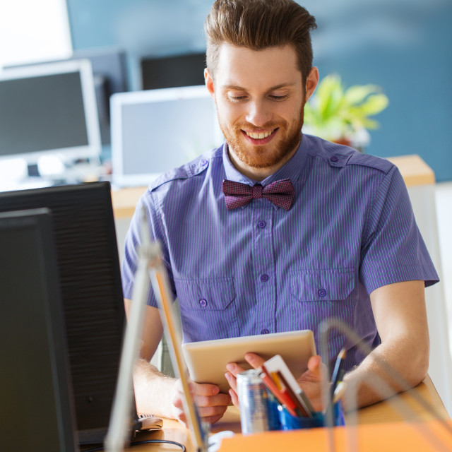 """""""happy creative male office worker with tablet pc"""" stock image"""
