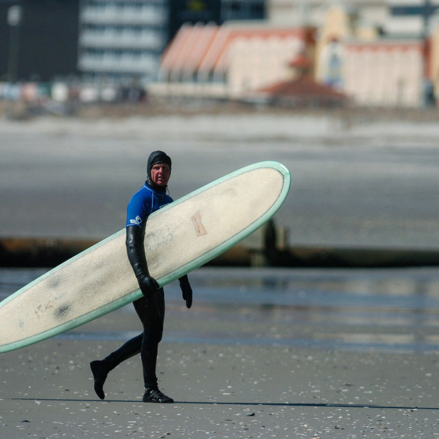 """Surfer Walks on Shore"" stock image"