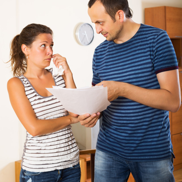 """""""Dissatisfied customer complains to agent"""" stock image"""