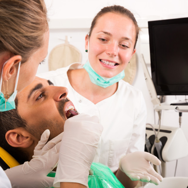 """Dentist examines the oral cavity"" stock image"