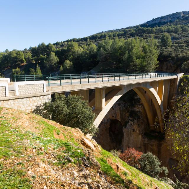 """Bridge in mountains"" stock image"