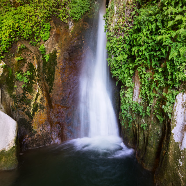"""""""Waterfall in rocky grot at mountains"""" stock image"""