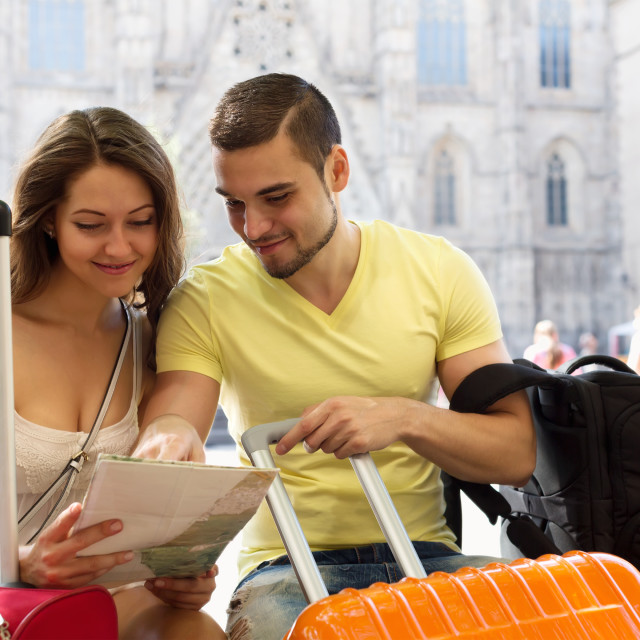 """Couple with map on city streets"" stock image"