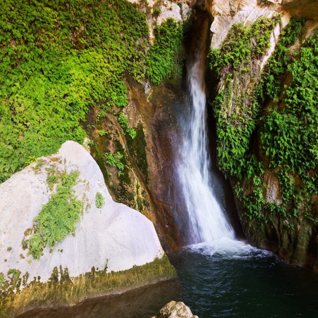 """""""Waterfall in rocky grot"""" stock image"""
