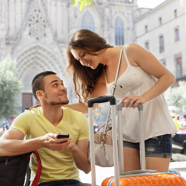 """""""Happy young travellers using phone navigating system"""" stock image"""
