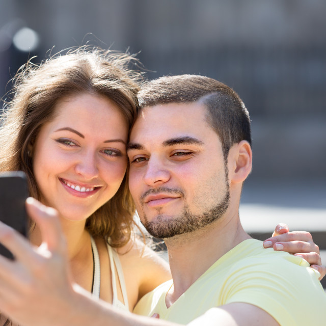 """""""Couple doing selfie at the street"""" stock image"""