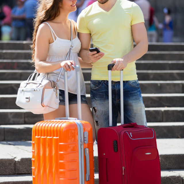 """""""Nice young travellers finding path with smartphone"""" stock image"""