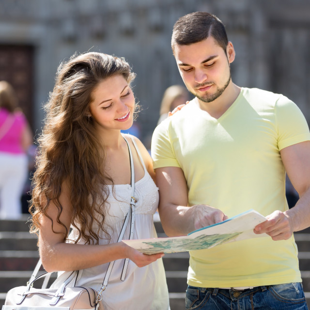 """""""Two friends reading the map"""" stock image"""