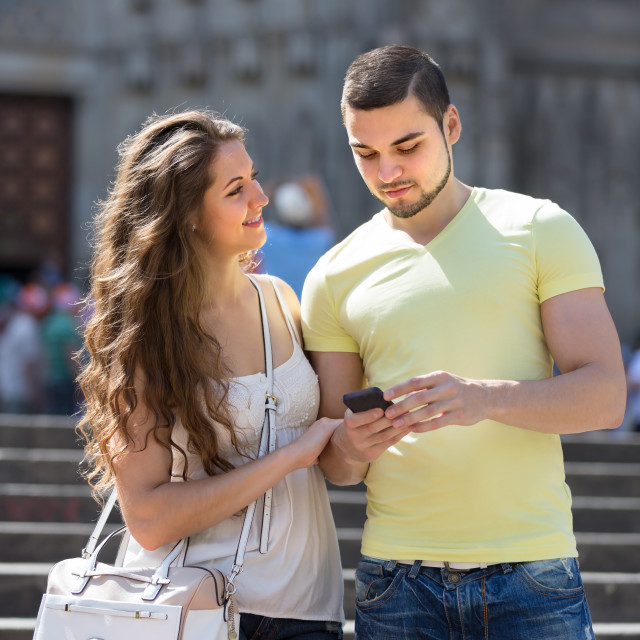 """""""Couple using the map at smartphone"""" stock image"""