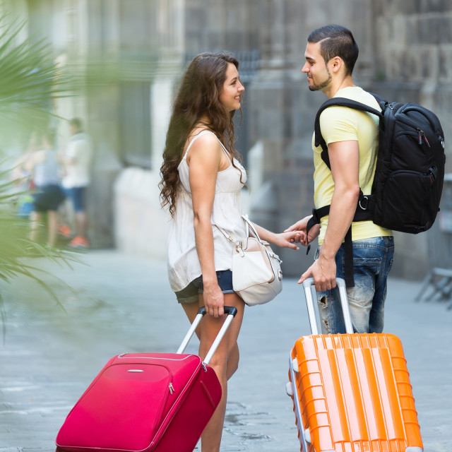 """""""couple with luggage in hand"""" stock image"""