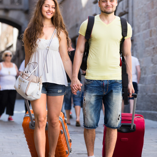 """""""Man and woman with bags"""" stock image"""