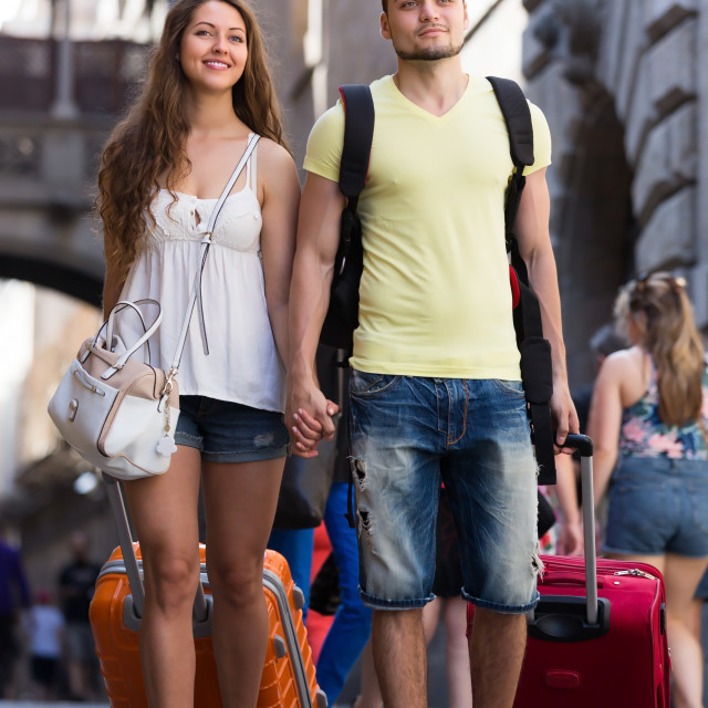 """""""Travelers with baggage in the street"""" stock image"""