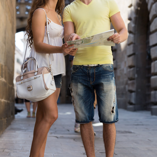 """Two friends with map in the street"" stock image"