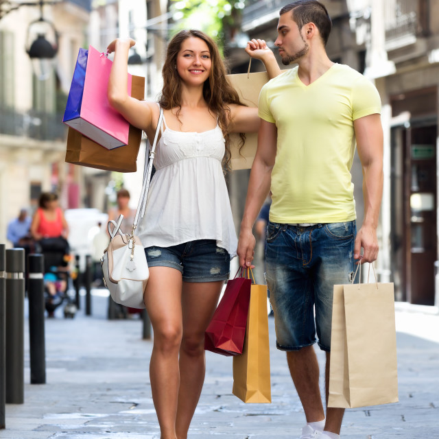 """Young tourists in shopping tour"" stock image"