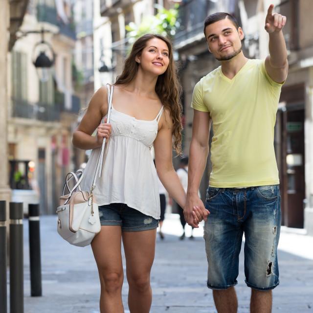 """Couple walking through city"" stock image"