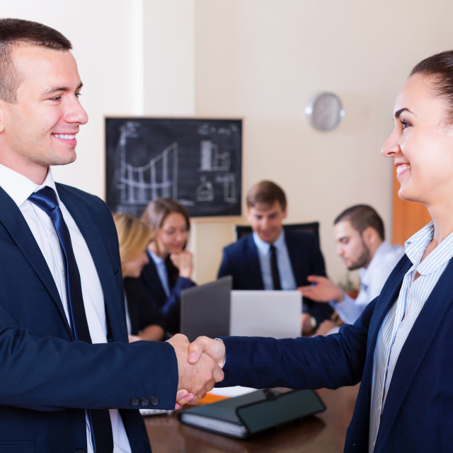 """""""Managers closing deal with shaking hands"""" stock image"""