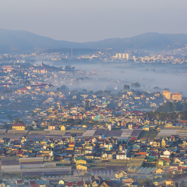 """Dalat city in the fog"" stock image"