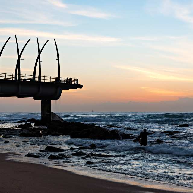 """Ritual at Sunrise at Umhlanga Rocks Pier"" stock image"