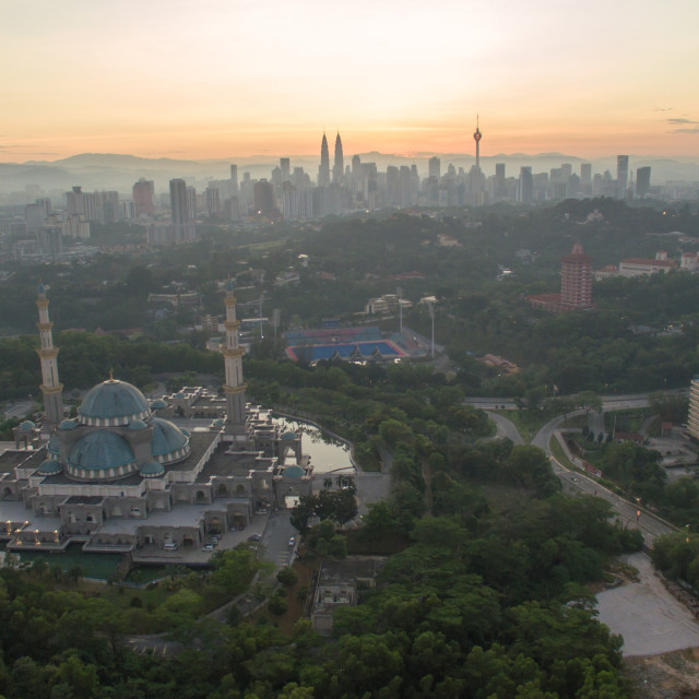 """""""Sunrise at Federal Mosque Kuala Lumpur, with silhouette city sky"""" stock image"""
