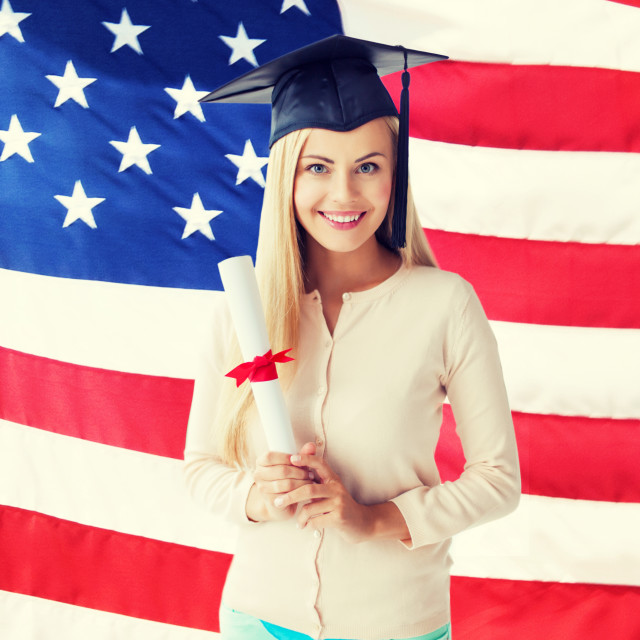 """""""student in graduation cap with certificate"""" stock image"""