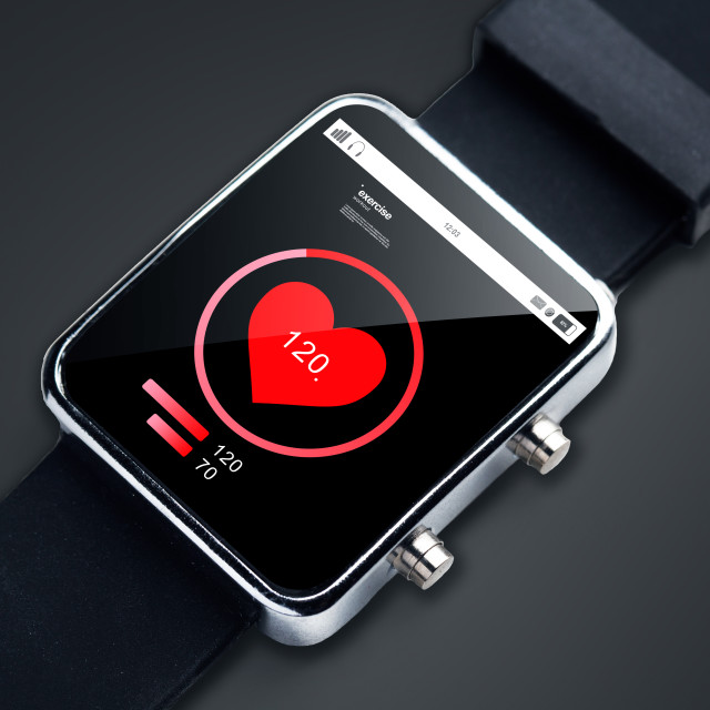 """close up of smart watch with pulsometer app"" stock image"