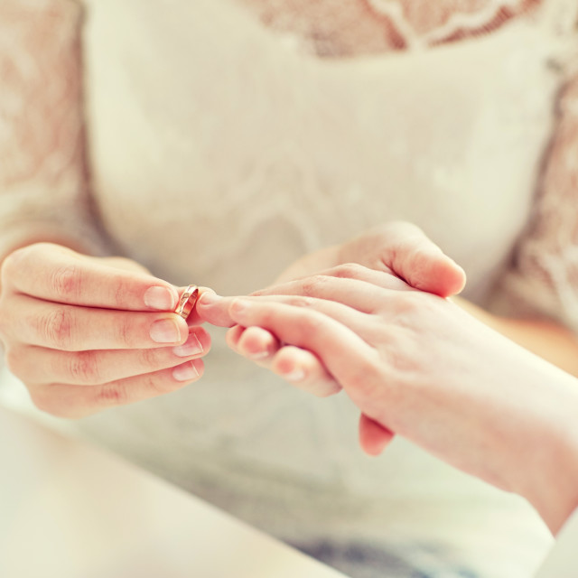 """close up of lesbian couple hands with wedding ring"" stock image"