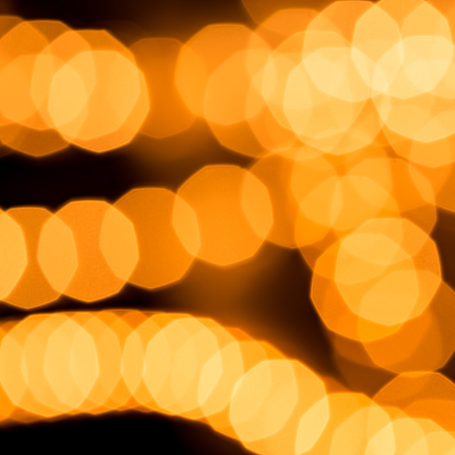 """Abstract golden background, circular bokeh, out of focus lights"" stock image"