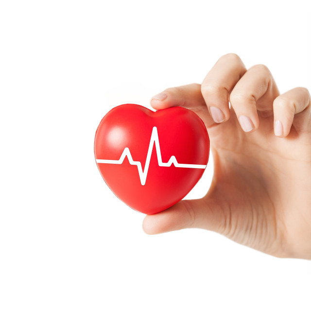 """close up of hand with cardiogram on red heart"" stock image"