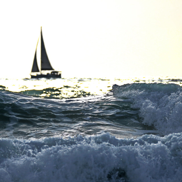 """""""A boat on the horizon"""" stock image"""