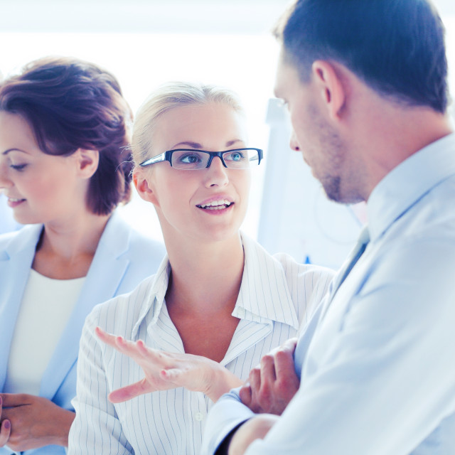 """""""man and woman having discussion in office"""" stock image"""
