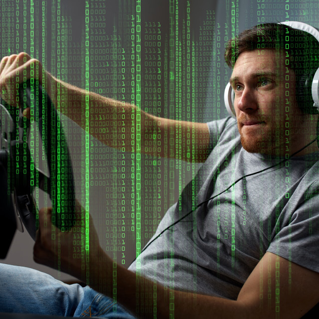 """man playing car racing video game at home"" stock image"